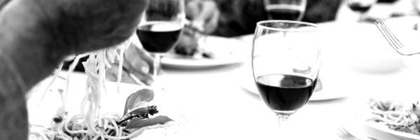 seniors-having-a-dinner-party-at-the-beach-WLH37B6-scaled-blackwhite