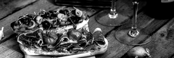 tapas-on-crusty-bread-with-red-wine-P2W8ASW-scaled-blackwhite